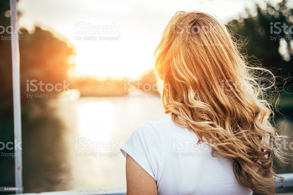 Rear view of beautiful blonde hair stock photo