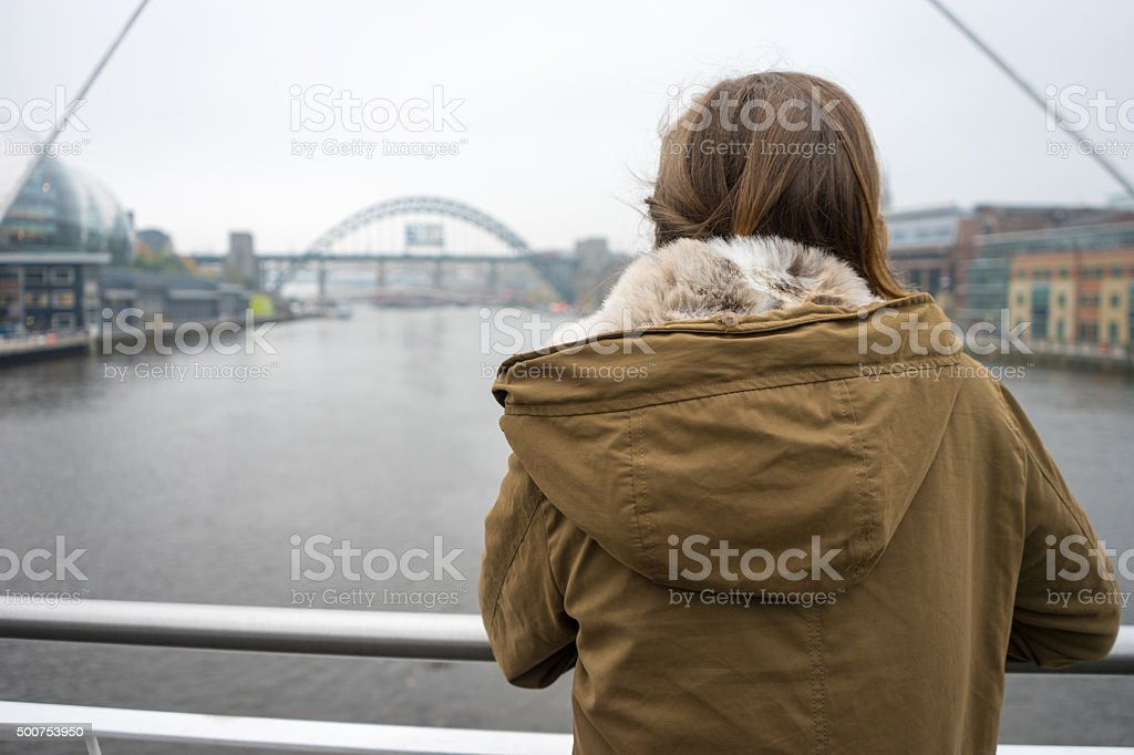 Rear view of Beautiful young woman looking down Tyne stock photo