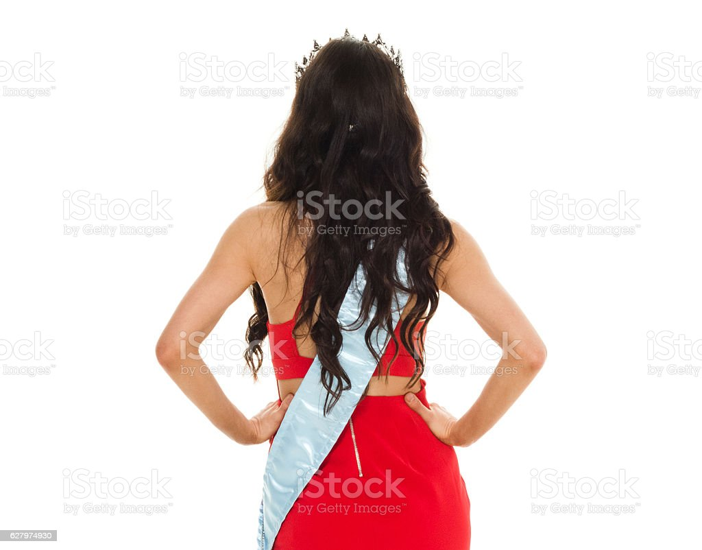 Rear view of beauty queen looking away stock photo