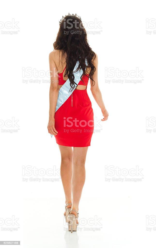 Rear view of beauty queen walking stock photo