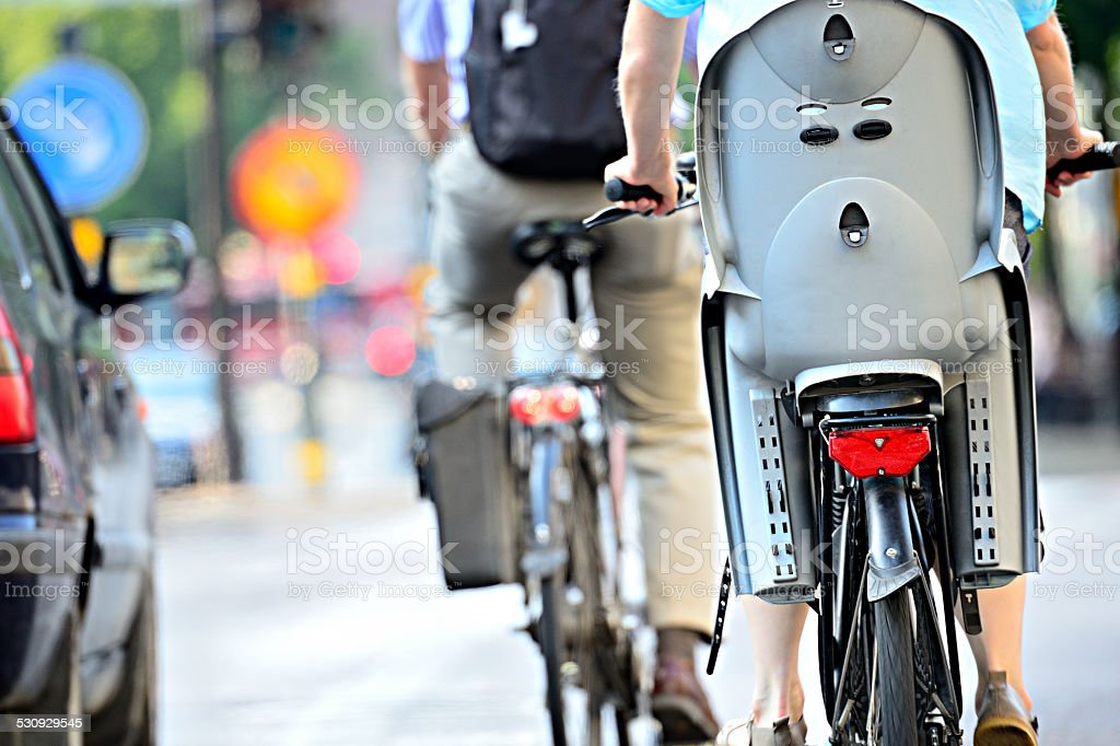 Rear view of bicyclist with child chair stock photo