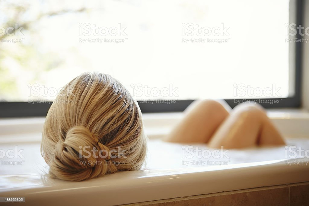 Rear view of blond woman in bath stock photo