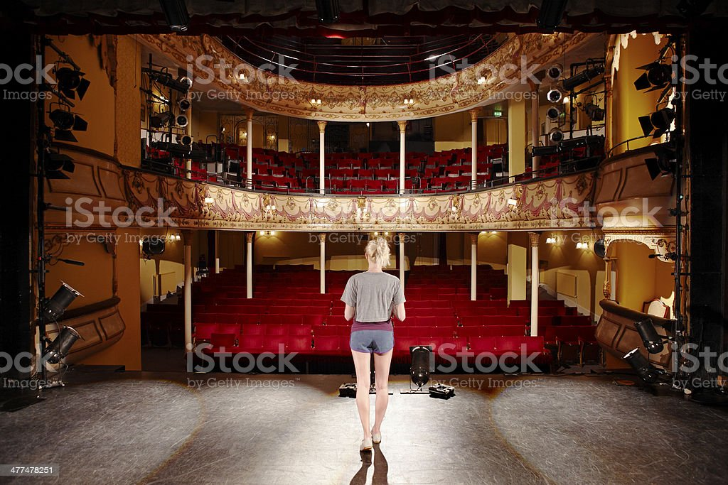 Rear View Of Blond Woman On Stage stock photo