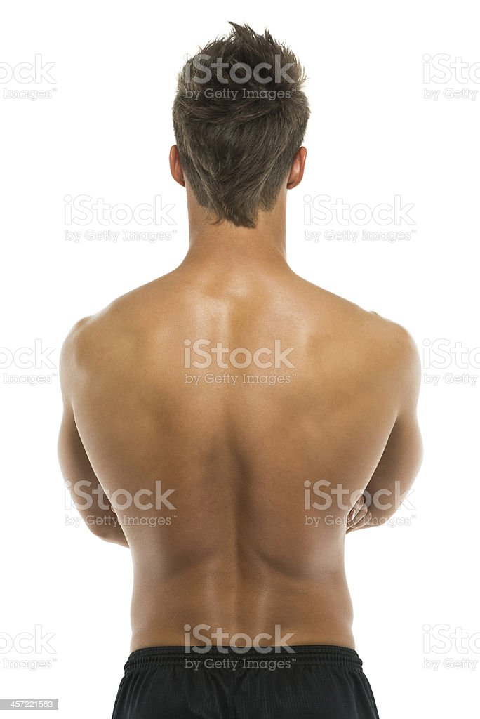 Rear view of body builder posing with arms crossed stock photo