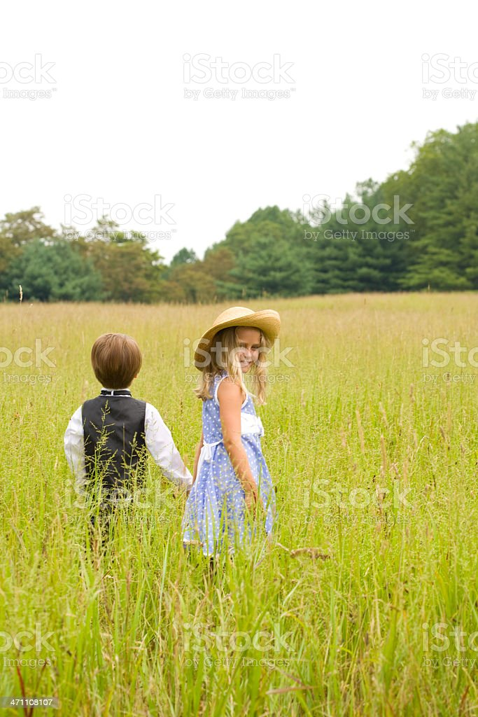 Rear view of boy with girl looking back over shoulder royalty-free stock photo