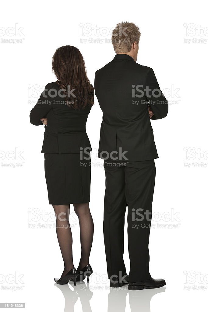 Rear view of business executives standing with arms crossed royalty-free stock photo