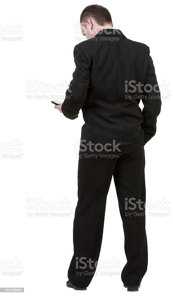 Rear view of business man in black suit royalty-free stock photo