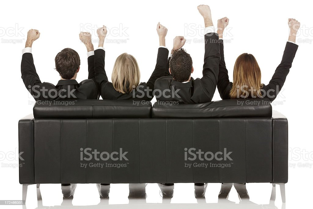 Rear view of business people with hands raised royalty-free stock photo