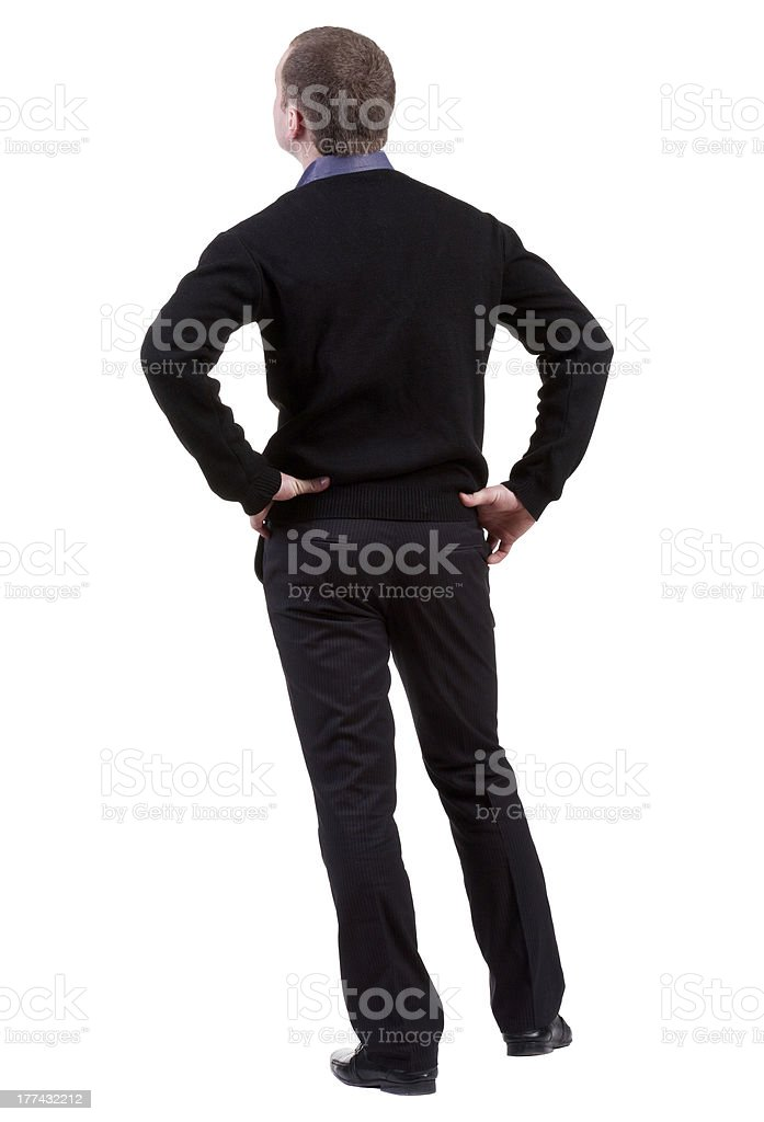 Rear view of businessman looking ahead stock photo