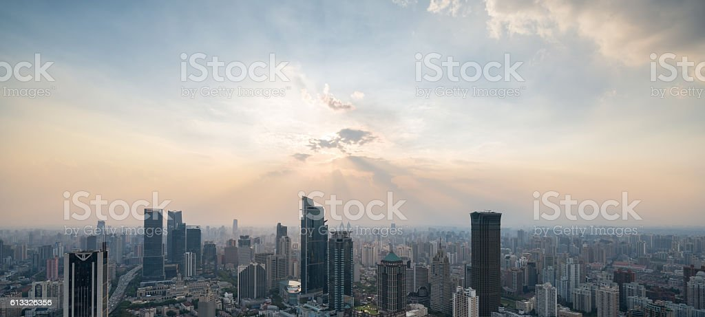 Rear view of businessman looking at sunset above shanghai city stock photo