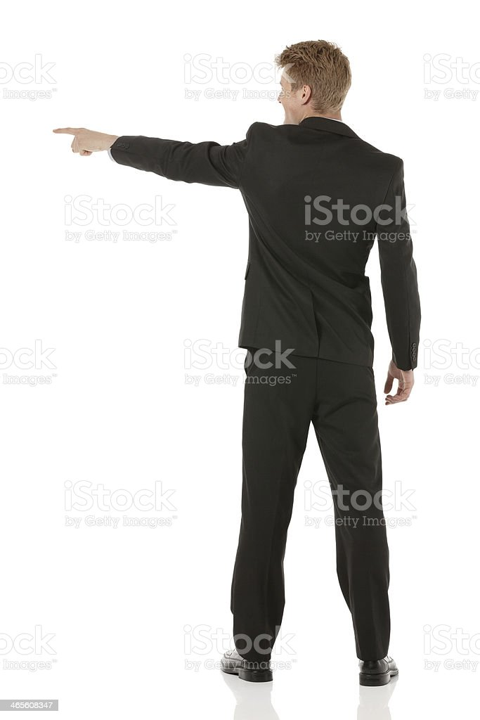 Rear view of businessman pointing royalty-free stock photo