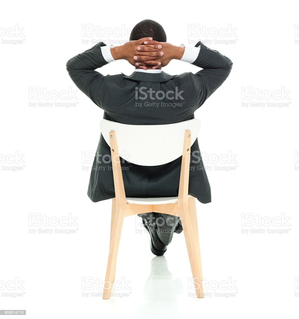 Rear view of businessman sitting on chair stock photo