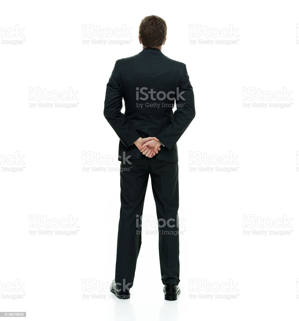 Rear view of businessman standing stock photo