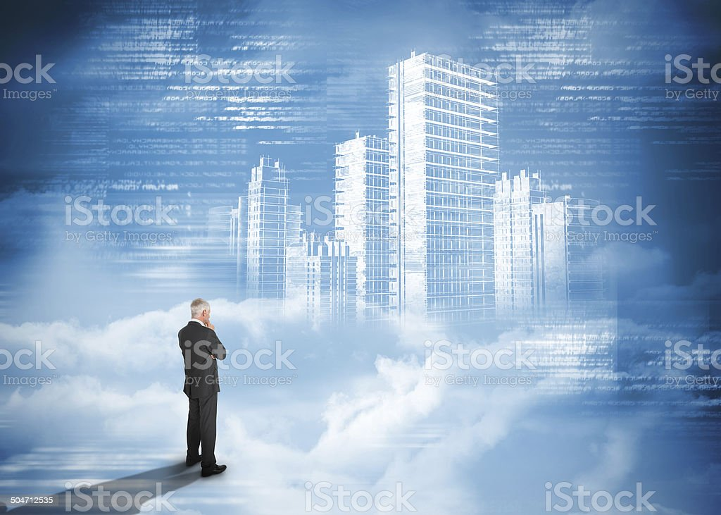 Rear view of businessman standing under holographic city stock photo