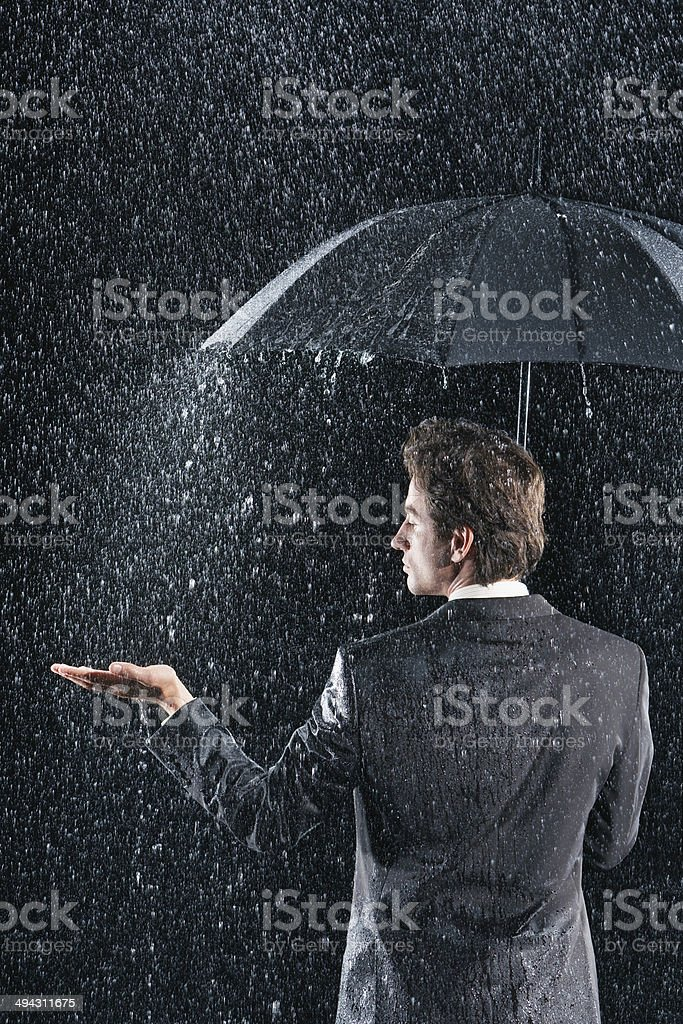 Rear View Of Businessman Under Umbrella royalty-free stock photo
