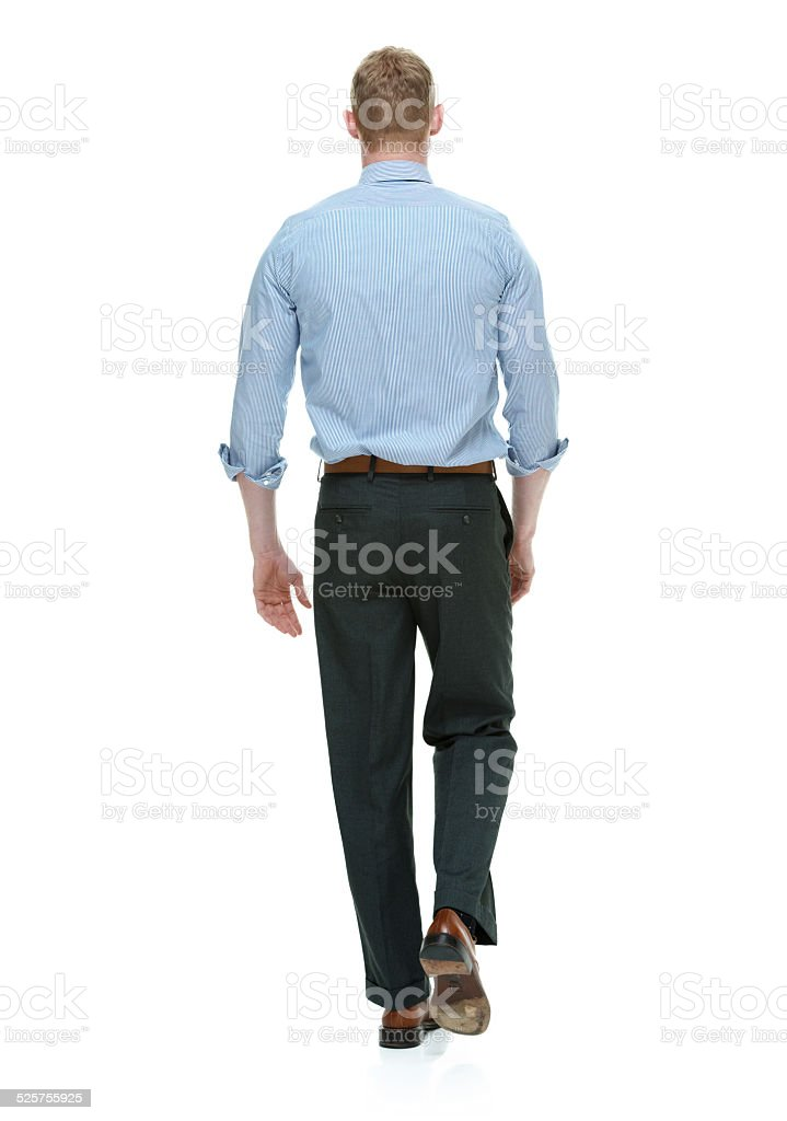 Rear view of businessman walking stock photo