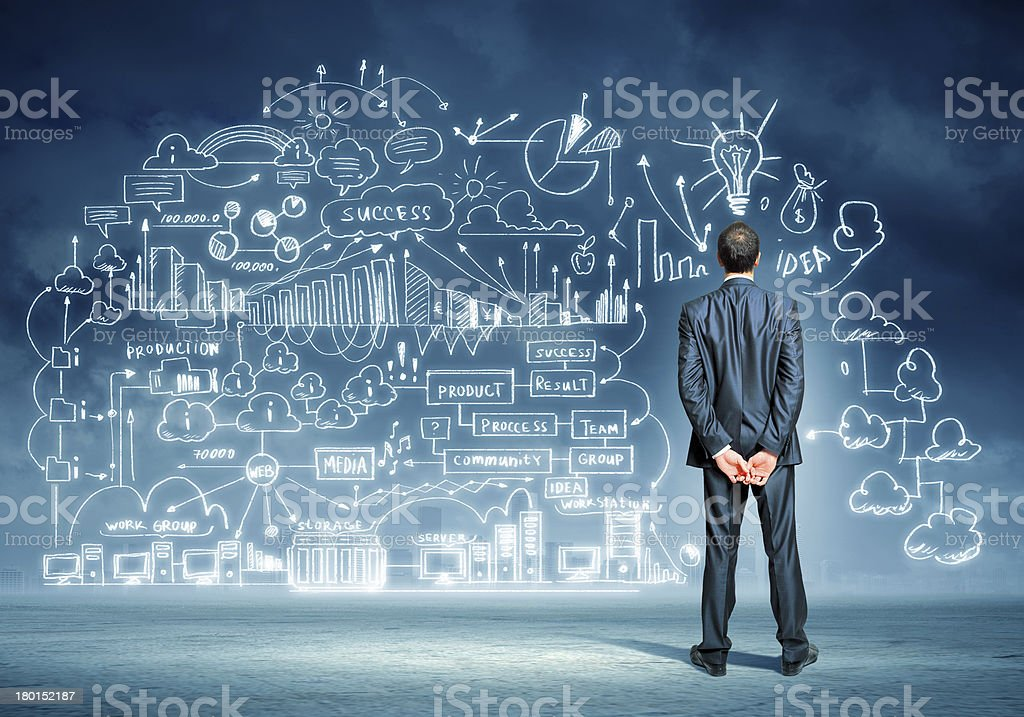 Rear view of businessman with abstract idea sketch stock photo