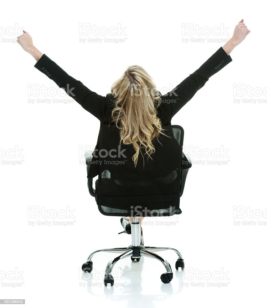Rear view of businesswoman cheering stock photo