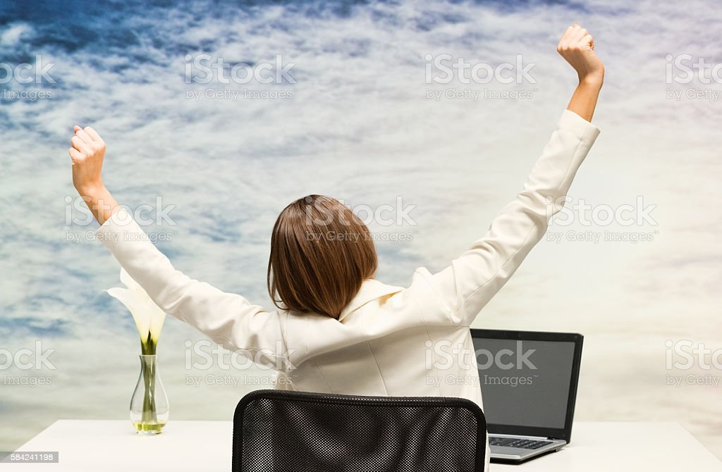 Rear view of businesswoman relaxing stock photo