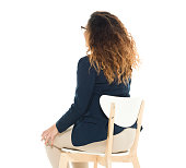 Rear view of businesswoman sitting on chair