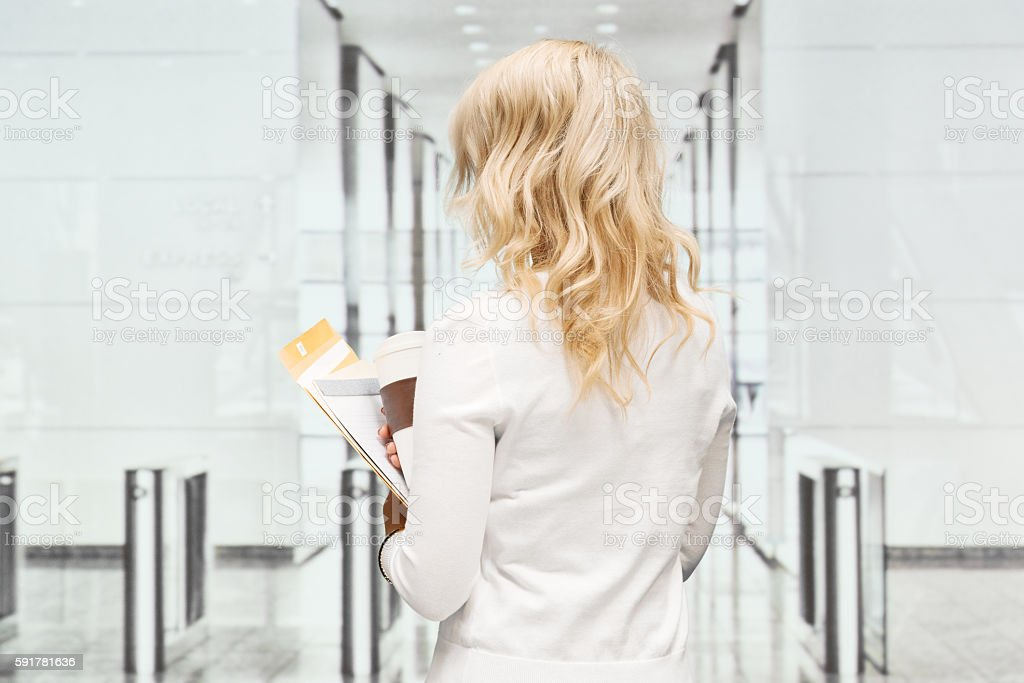 Rear view of businesswoman standing in office stock photo