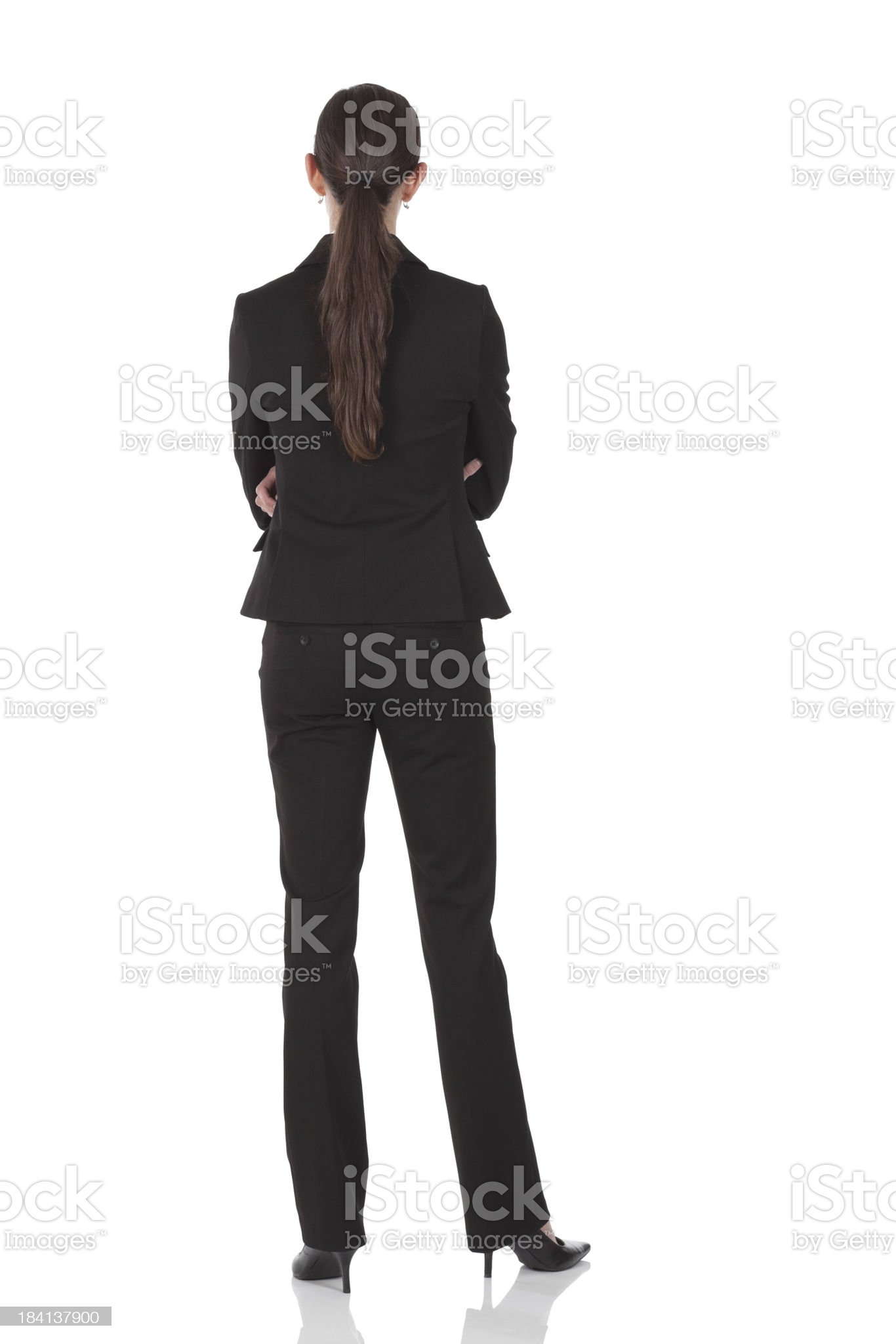 Rear view of businesswoman standing with arms crossed royalty-free stock photo