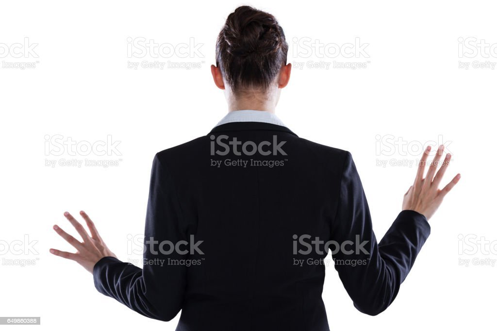 Rear view of businesswoman using digital screen royalty-free stock photo
