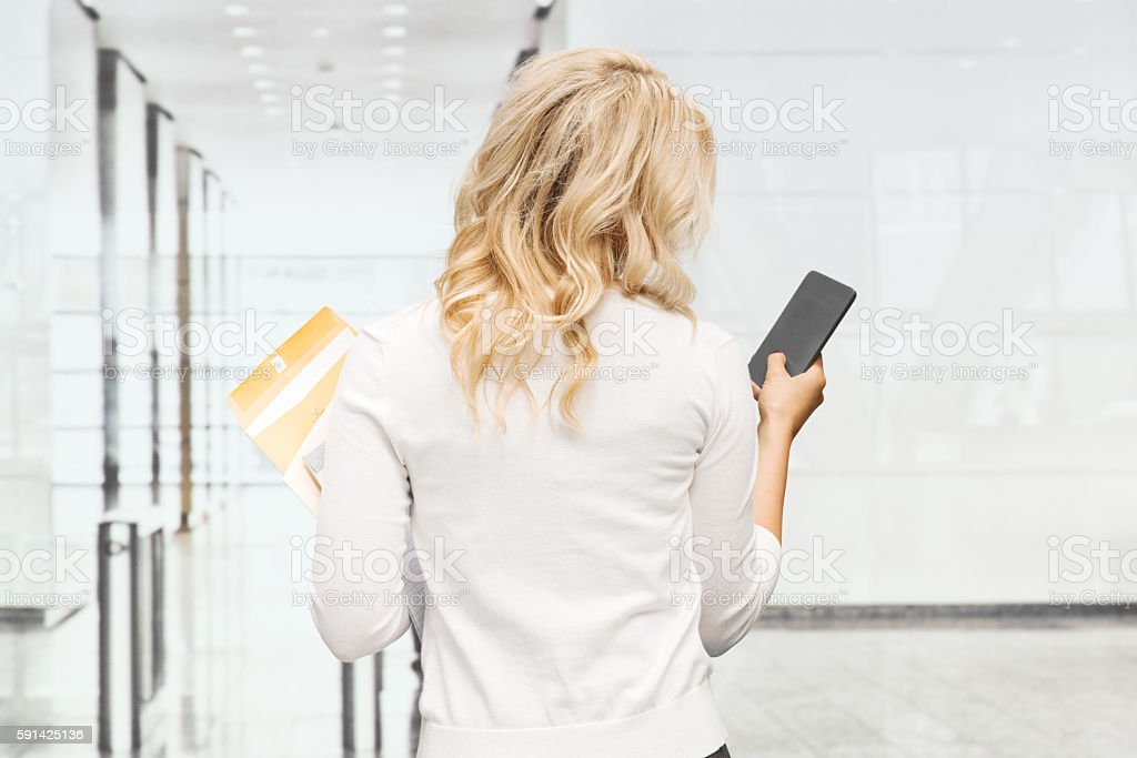 Rear view of businesswoman using phone stock photo