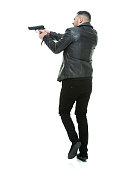 Rear view of casual man aiming with gun