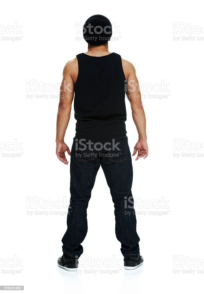 Rear view of casual man looking away stock photo