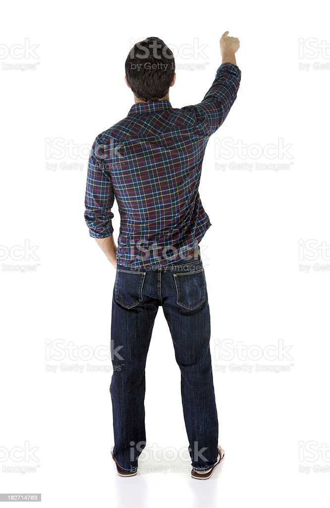Rear view of casual man pointing stock photo