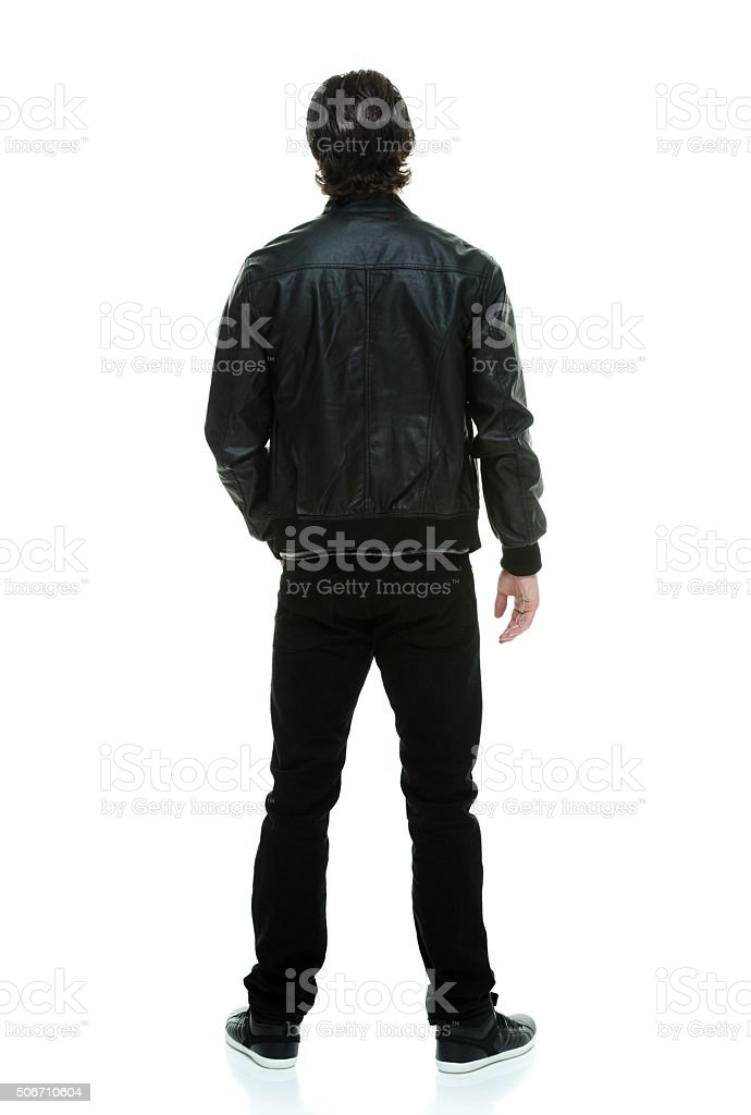 Rear view of casual man standing stock photo