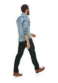 Rear view of casual man walking
