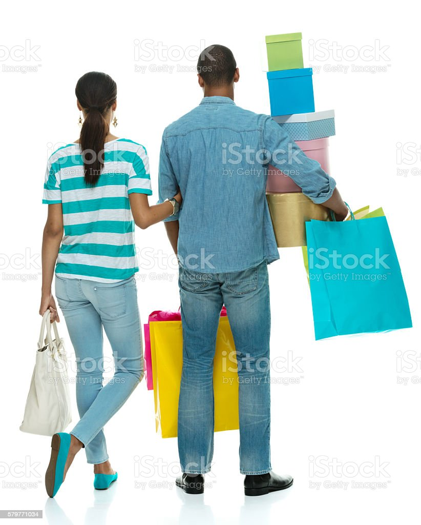 Rear view of couple standing with gift box stock photo