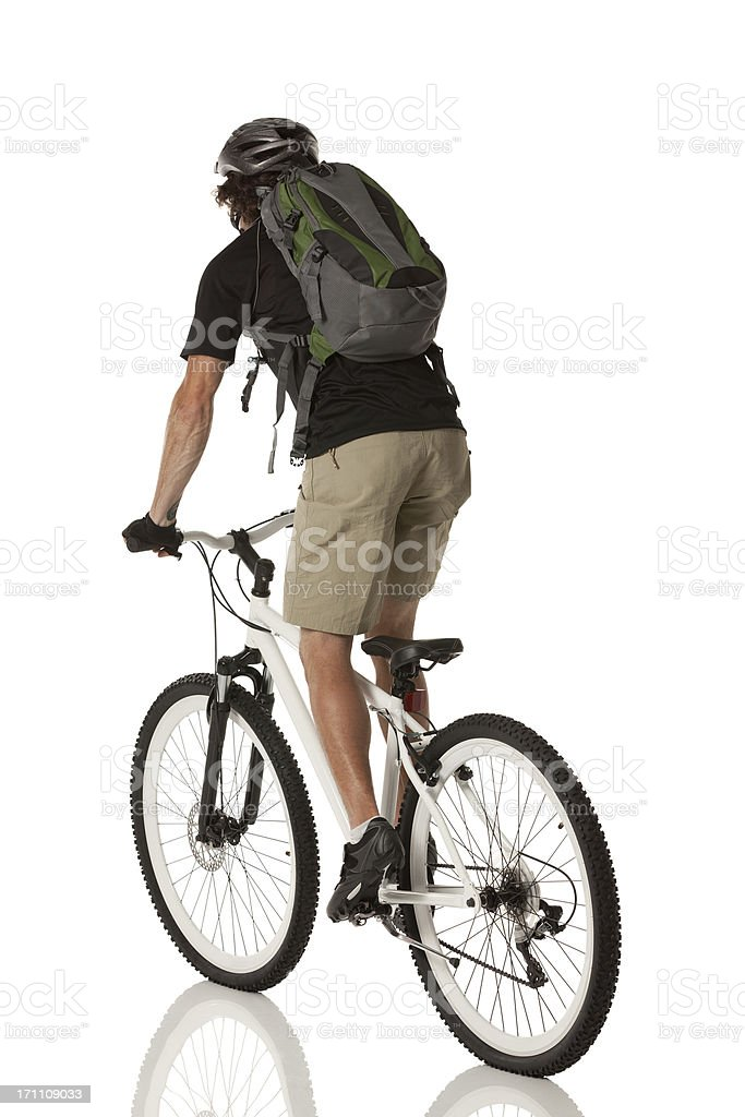 Rear view of cyclist riding a bicycle royalty-free stock photo