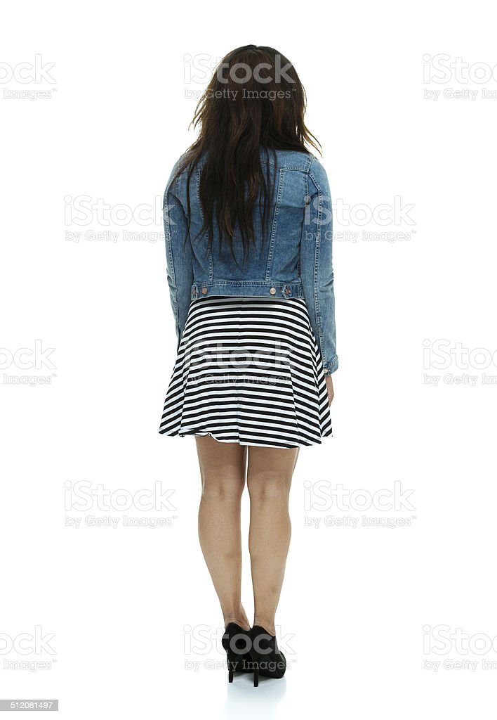 Rear view of fashionable woman standing stock photo