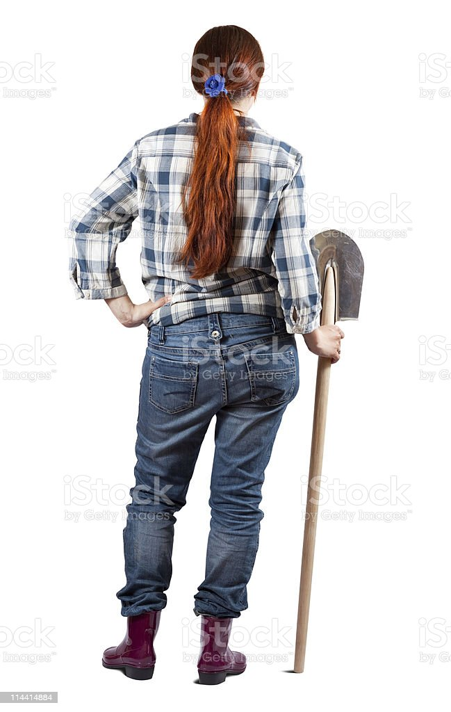 Rear view of female farmer with spade royalty-free stock photo