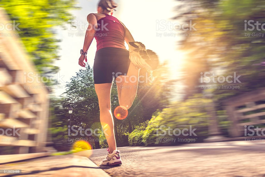 Rear view of female jogger in a park stock photo