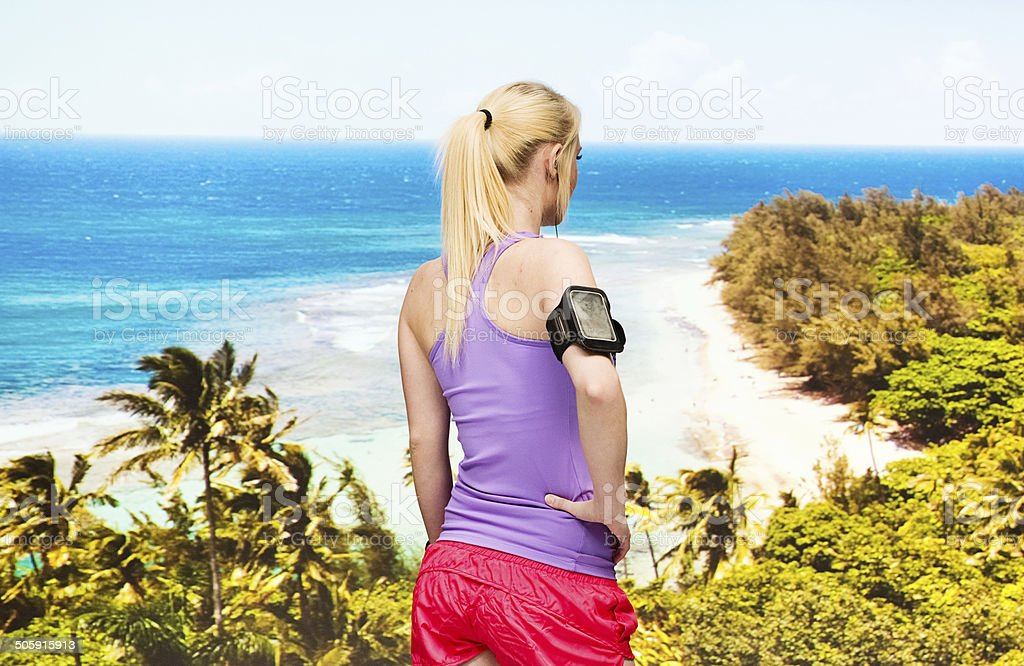 Rear view of female runner standing at beach royalty-free stock photo