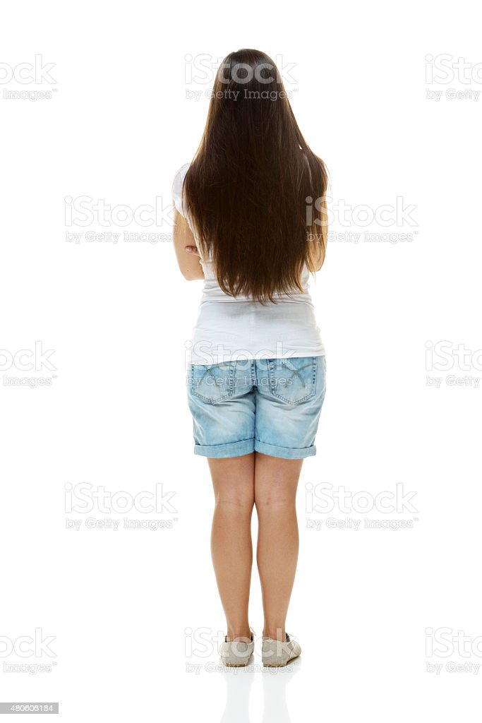 Rear view of female standing stock photo