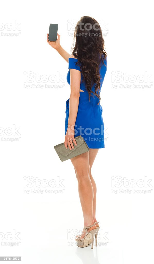 Rear view of female taking a selfie stock photo