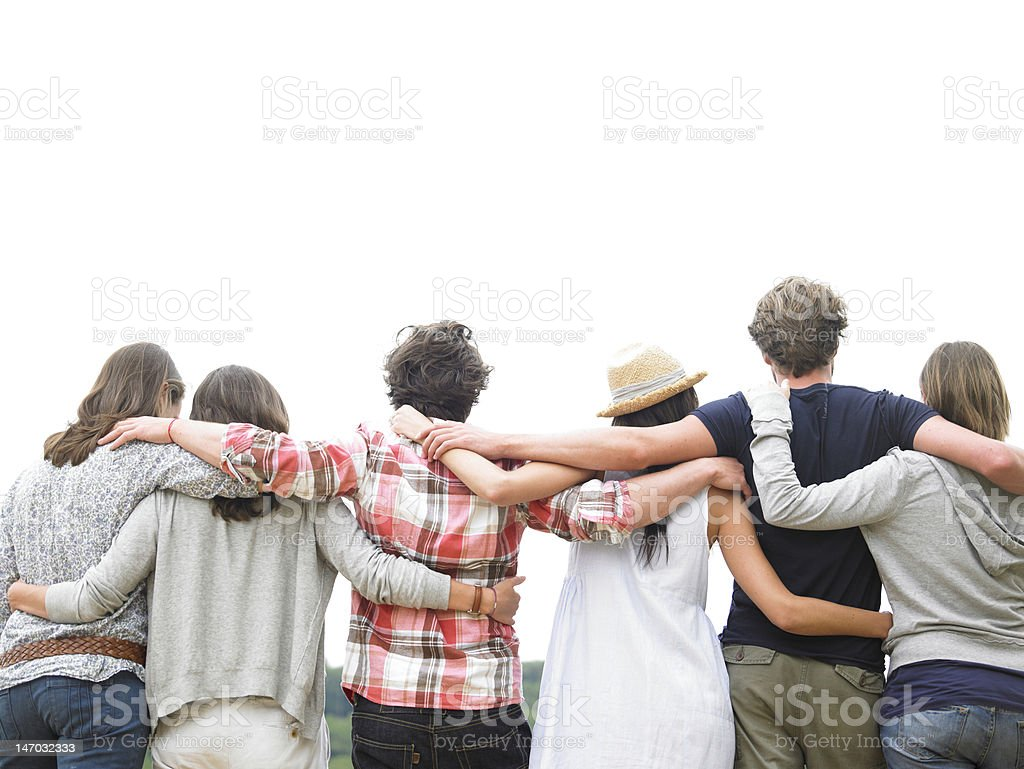Rear View of Friends Hugging stock photo