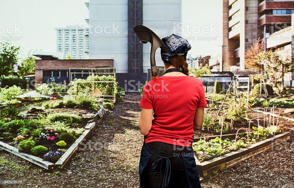 Rear view of gardener in garden stock photo