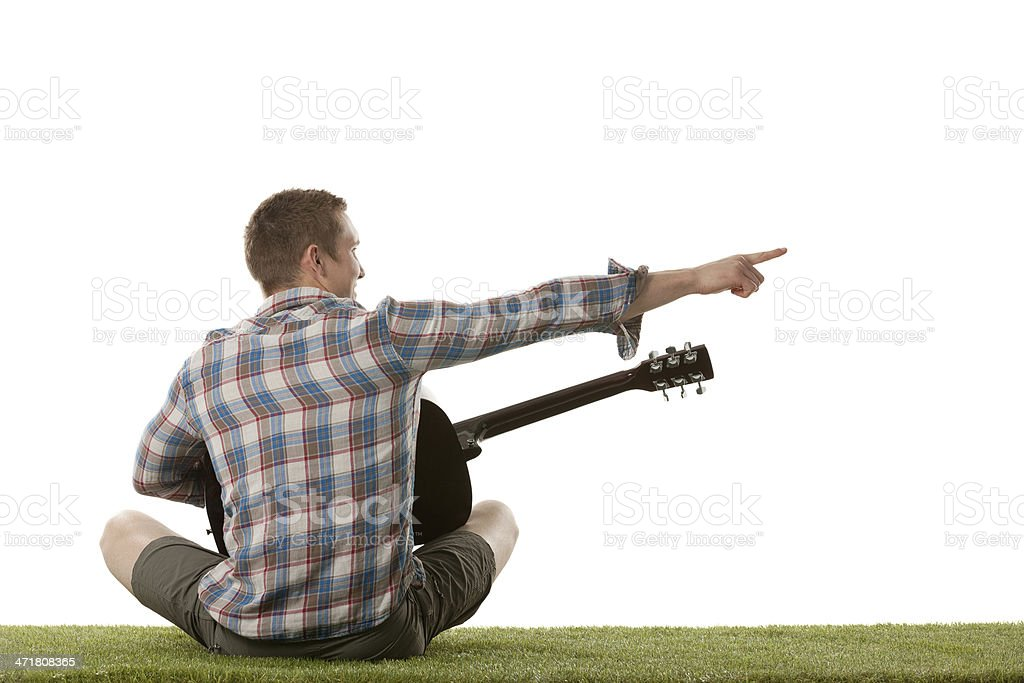 Rear view of guitarist pointing sideways royalty-free stock photo