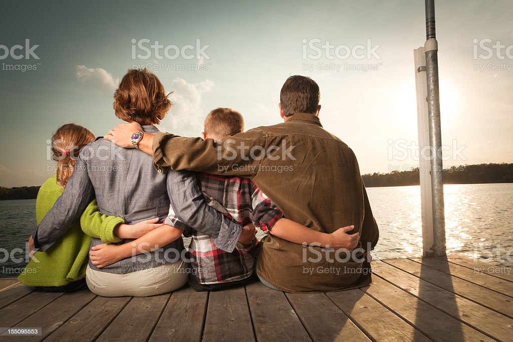 Rear View of Happy Family Embracing, Vacation Holiday in Lake stock photo