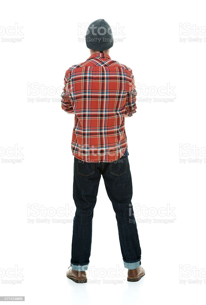 Rear view of hipster standing stock photo