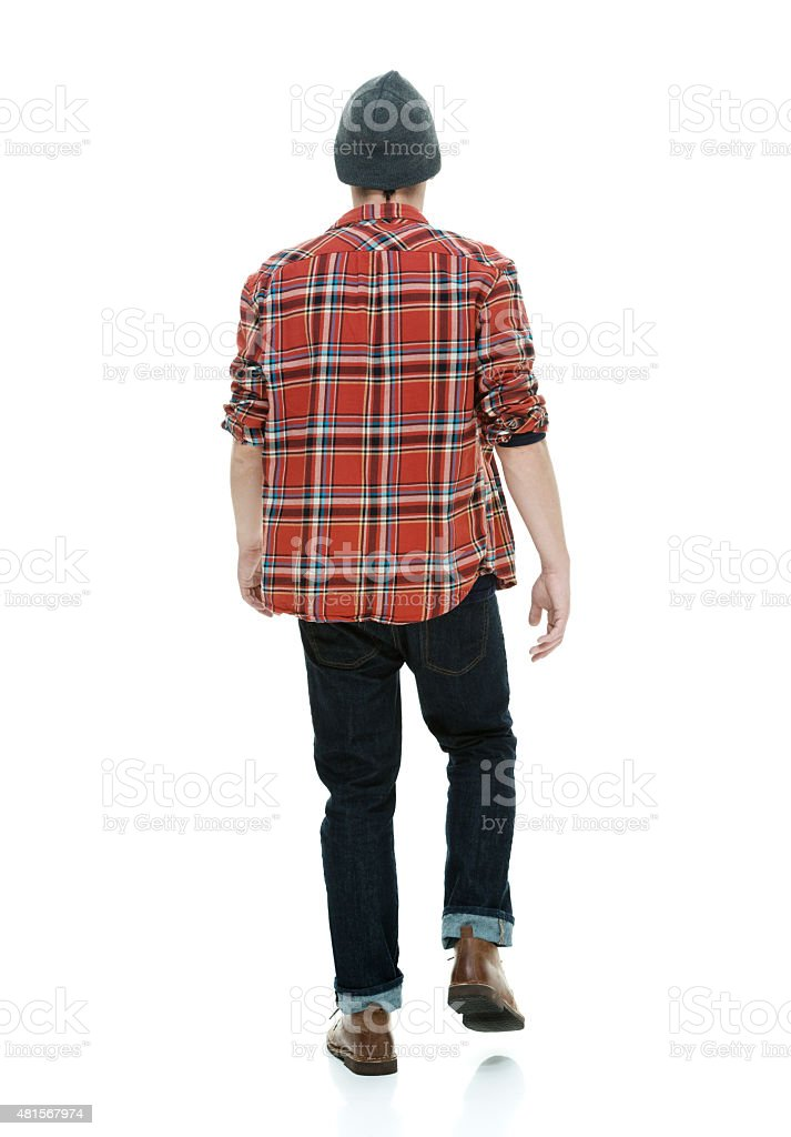 Rear view of hipster walking stock photo