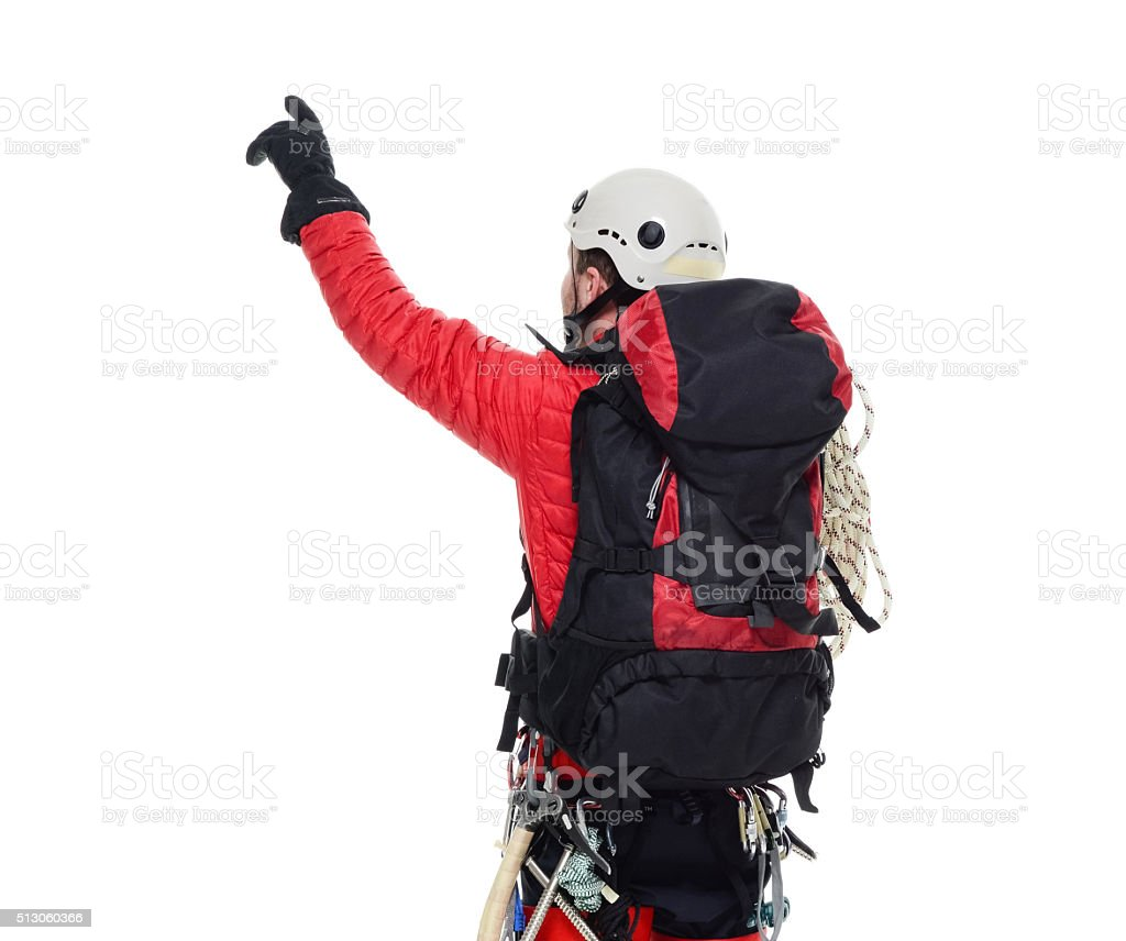 Rear view of ice climber pointing away stock photo