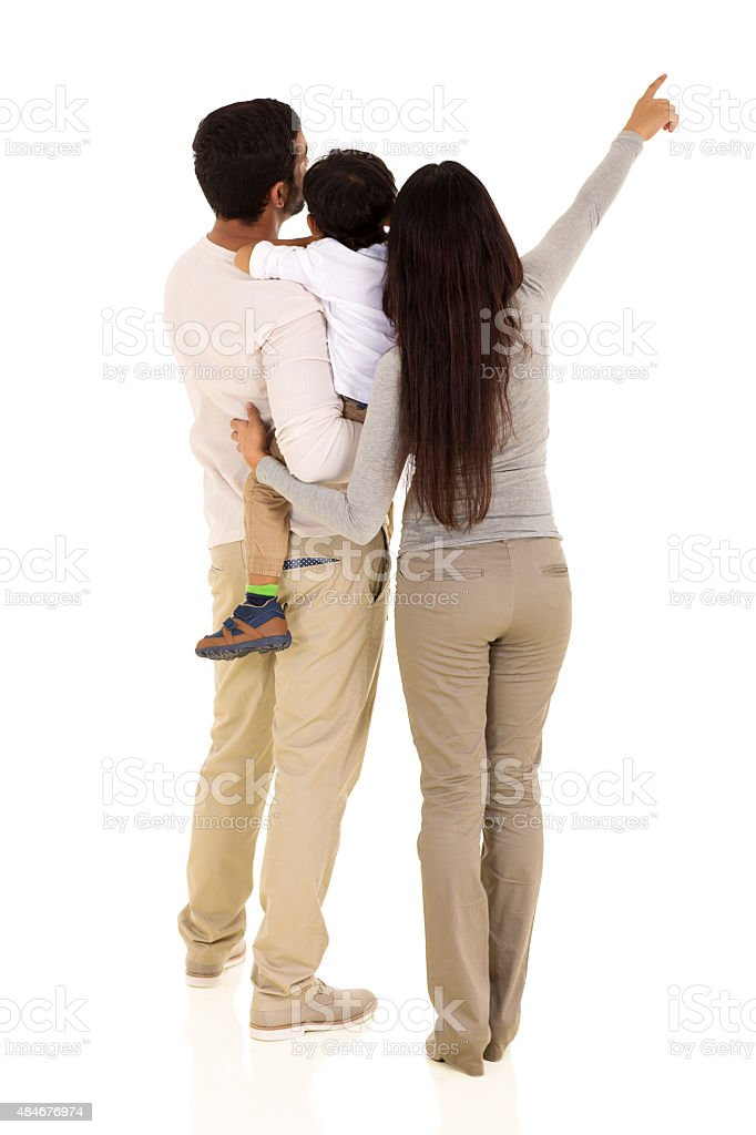 rear view of indian family pointing stock photo