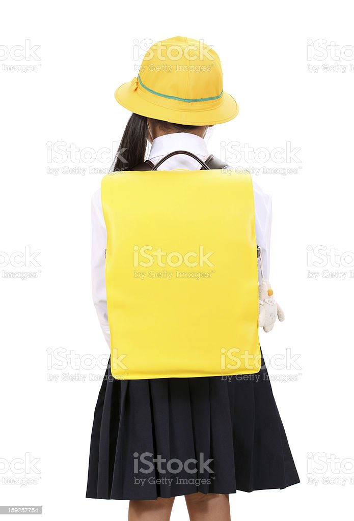 Rear view of little asian schoolgirl royalty-free stock photo